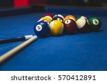 billiard balls on blue table... | Shutterstock . vector #570412891
