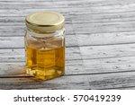 honey in a mason jar on a... | Shutterstock . vector #570419239