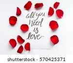Stock photo calligraphy floral pattern top view all you need is love 570425371