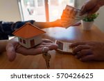close up of hands giving house... | Shutterstock . vector #570426625