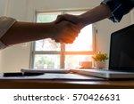 business people shaking hands ... | Shutterstock . vector #570426631