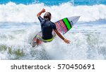 riding on the waves. costa rica ... | Shutterstock . vector #570450691