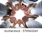 happy volunteers standing with... | Shutterstock . vector #570463264
