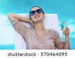 business woman with a glass of... | Shutterstock . vector #570464095