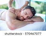 man receiving back massage from ... | Shutterstock . vector #570467077