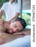 man receiving back massage from ... | Shutterstock . vector #570467101