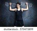 funny weak guy raises heavy... | Shutterstock . vector #570473899