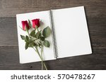 Stock photo blank notebook with red roses copy space for your text 570478267