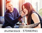 happy young couple listening to ...   Shutterstock . vector #570483961