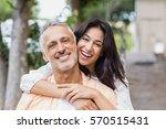 beautiful woman embracing man... | Shutterstock . vector #570515431