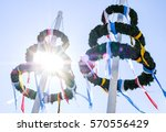typical bavarian maypole in front of blue sky - stock photo