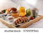 breakfast in bed with fruits...   Shutterstock . vector #570559561