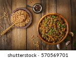 lentil with carrot and onion in ... | Shutterstock . vector #570569701