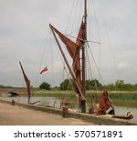 A Thames Barge Moored At The...