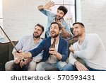 handsome cheerful friends... | Shutterstock . vector #570593431