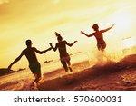 happy friends runs to the sea....   Shutterstock . vector #570600031