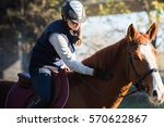 Stock photo young pretty girl riding a horse 570622867