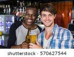 happy friends having a drink in ... | Shutterstock . vector #570627544