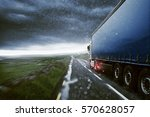 truck drives through the rain | Shutterstock . vector #570628057