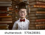 toddler between books | Shutterstock . vector #570628081
