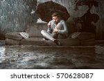 man in his flooded flat | Shutterstock . vector #570628087