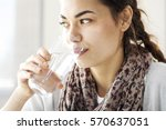 young woman drinking water | Shutterstock . vector #570637051