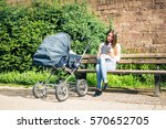 young mother with baby stroller ... | Shutterstock . vector #570652705