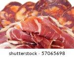 a pile of different spanish embutido, jamon and chorizo - stock photo