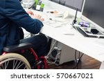 man sitting in wheelchair... | Shutterstock . vector #570667021