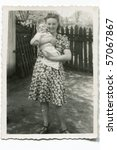 Vintage photo of young mother with her baby (forties) - stock photo
