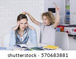 child annoying his tired mother ...   Shutterstock . vector #570683881