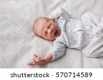 Portrait Of Newborn Baby Lying...