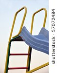 Closeup of a colorful slide with ladder - stock photo