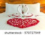 Stock photo beautiful hotel for honeymoon sweet swan couple put on honeymoon bed look like heart shape with 570727549