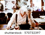 mobsters sitting and smoking a... | Shutterstock . vector #570732397