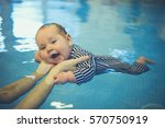 a little baby is swimming in a... | Shutterstock . vector #570750919