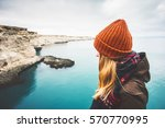 young woman enjoying cold sea... | Shutterstock . vector #570770995