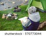 cooking breakfast in the... | Shutterstock . vector #570773044