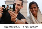 tourist taking a selfie with a... | Shutterstock . vector #570812689