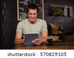 man using a tablet in a coffee... | Shutterstock . vector #570829105