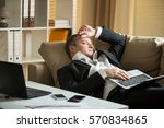 businessman in suit lying on a...   Shutterstock . vector #570834865