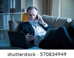businessman in suit lying on a...   Shutterstock . vector #570834949