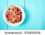 fresh bacon in white bowl on... | Shutterstock . vector #570835039