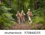boys and girl go hiking with... | Shutterstock . vector #570868255