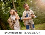 boys go hiking with backpacks... | Shutterstock . vector #570868774