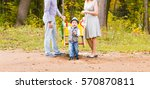 Playful Child With Parents At...