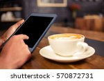 woman drinking coffee and using ... | Shutterstock . vector #570872731