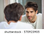 young man looking himself in... | Shutterstock . vector #570923905