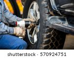 mechanician changing car wheel... | Shutterstock . vector #570924751