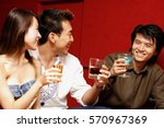 young adults toasting with... | Shutterstock . vector #570967369
